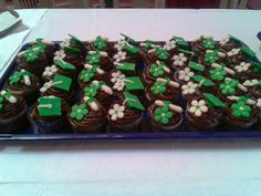 Green and white graduation cupcakes
