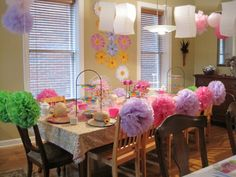 Tea party for our five year old daughter. Hubs and I had biggest argument ever over hanging those poofs and lanterns! http://ateachablemom.com/2013/06/10/why-i-should-be-mother-of-the-year/