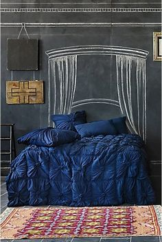 bed and chalkboard headboard