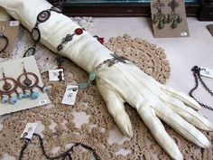 A stuffed glove is ALWAYS a great jewelry display.   This one is part of Joan William's show booth.  Find Joan at Lil Ruby at Etsy.