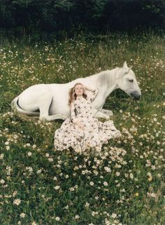 horse and girl in a field of daisies//