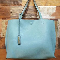 Large reversible tote This blue is the 2016 black,  Amazing quality,  vegan feels like leather, looks like leather,  you can fit in it ALL.  Shop, go to school. the beach. travel.. Street level  Bags Totes