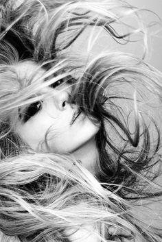 Wild hair. Awesome photo.