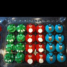 Angry Bird cupcakes! Mint chocolate piggies sprinkled w green sugar, a 1/2 of a marshmallow is frosted too in order to have the snout look and 2 mini morsel chocolate chips for the nostrils, red frosting for the tongue, mini marshmallows for the teeth, and jelly  beans for the ears. Cherry red birds using dyed coconut (red food coloring and coconut). Tummies are made from marshmallows cut into thirds but I didn't use the middle piece on any of my birds. Cotton candy blue birds are simply…