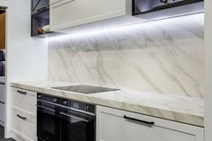 Add drama to you kitchen with recessed lighting, a stunning bench and matching splash back, designed and built y KMD Kitchens Auckland, Kitchen Lighting, Tile Floor, Kitchens, Drama, Bench, Flooring, Home, Design