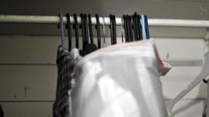 Move a closet full of clothes with a single trash bag: Just get the largest trash bag you can find, pull it around hanging clothes from the bottom, then cinch up the top so the hangers don't fall in. Once you get the bundle to your new home, you should be able to hang the entire collection at once in your new closet.