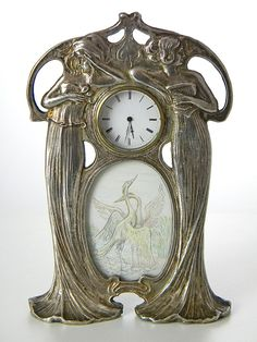 Rare Classy Art Nouveau table clock with round clock face and very fine coloured painting below glass, showing two cranes