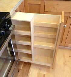 Alternate storage for spices that could be especially helpful for people who use wheelchairs. So that spices will not dry excessively, this cabinet might be better placed farther from the oven.