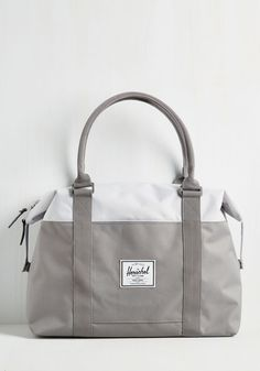 Stay on top of your action-packed schedule by toting your belongings in this grey duffel from Herschel Supply Co. Boasting padded handles, optional snap-down sides, and two-way zipper pulls, this sturdy bag makes your busy days away a stylish breeze! Tote Backpack, Messenger Bag, Tote Bags, Mochila Tote, Leather Briefcase, Leather Bags, Pink Leather, Camo Purse, Stylish Backpacks
