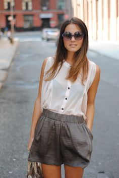 pleated shorts with romantic blouse