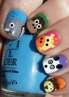 Cute Animal Nail Art Look Featuring An Elephant, A Monkey, A Giraffe, A Panda, and A Lion Made With OPI Nail Polish! The detail makes it precious!