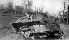 In the foreground, a German Sd.Kfz. 251/1 Ausf. D Panther. In the background, an American M10 Tank Destroyer with a counterweight attachment.