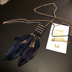 """Blue Crystal Tassel and Feather Necklace Beautiful Sapphire blue crystal three layered pendant with feather tassels.  32"""" length, 3"""" extension Lobster clasp T&J Designs Jewelry Necklaces"""