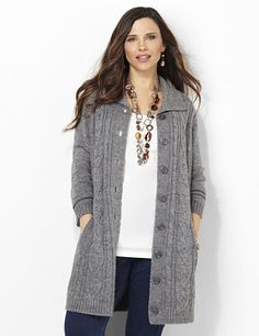 Sumptuously soft, this cable knit cardigan warms you up during crisp autumn nights. Buttonfront style layers over every outfit for endless, seasonal looks. Ribbing detail accents the collar, hem and ends of the long sleeves for added fit. Complete with a solid pattern on the back. Catherines tops are designed for the plus size woman to guarantee a flattering fit. catherines.com