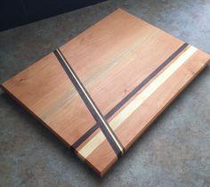 Cherry w/ Maple & Walnut diagonal stripes, along w/ slight bevel edge give this cutting board a modern look. 1979woodwork.com