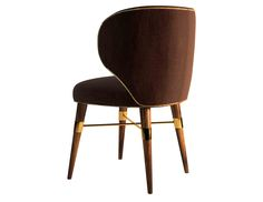 With brown velvet and a contrasting golden cord, a classic design radiates from this chair's modern lines. The Louis dining chair rests on solid walnut legs with signature brass accents.