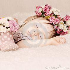 Sleeping baby girl in flowers, beautiful vintage background