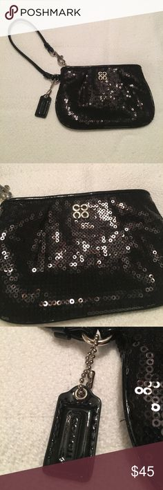 NWOT Coach sequined wristlet Black sequined wristlet. Never used! In perfect condition. Has purple lining. Coach Bags Clutches & Wristlets