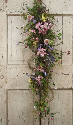 Thinking about making something like this for my front door for Spring instead of round wreath