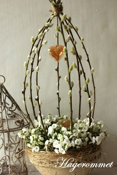 "alternatively, we can make pussy willow ""bird cages"" with floral arrangements (more colorful and voluptuous than in this example). can place a little bird inside each one, petals all around, etc."