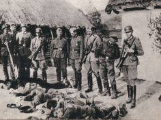The executioners pose with their handiwork: German killing squad and Polish farmers murdered in occupied Poland, 1943.