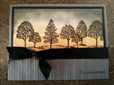 Sunset card made with Stampin Up's Lovely as a Tree stamp set - trees were stamped in Versamark and embossed with black embossing powder over a sponged background.  The picture doesn't do it justice!