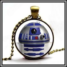 """STAR WARS NECKLACE ✨  ✨NWOT✨ Who said Star Wars is a male obsession!?!   Beautiful Star Wars glass cabochon necklace depicting the adorable R2D2                    Bronze chain is ~22""""    Pendant ~1"""" across Jewelry Necklaces"""