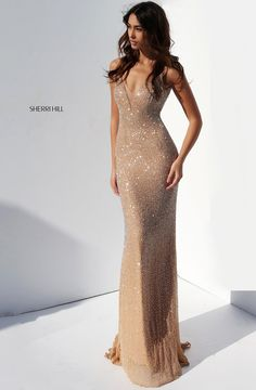 Champagne doesn't sparkle as bright as you in Sherri Hill 50860. Decked out in intricate beading from start to finish, this long, fitted gown features an illusion plunge neckline, spaghetti straps, and an open, V-shaped back. Shimmer in the sunlight, moonlight, or spotlight, this dress will make you feel like a star. Select this look for your next red carpet event, birthday celebration, romantic night out, or prom.