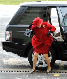 Britain's Queen Elizabeth II arrives in high winds for a visit to RAF Valley in Wales on 1 Apr 2011