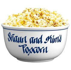 """For your pal with the 55"""" flat screen who pops """"fresh"""" corn -- Stoneware Popcorn Bowl"""