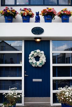 Dark blue front doors are believed to create calm and peace for your home...in turn, bringing those feelings to your guest and family who enter through and into your home. Additionally, blue is thought to bring lots of positive energy into a space