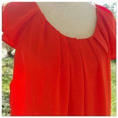 Salmon blouse 25 bust 26 length beautiful salmon orange coral blouse.  Beautiful pleated neckline.  Sweet ruffle sleeves.  100% polyester boutique Tops Blouses