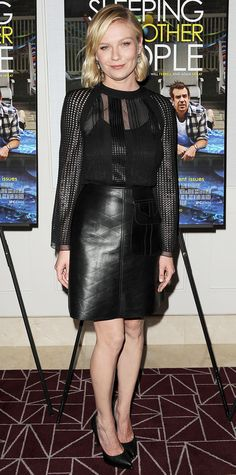 At the Sleeping With Other People screening, Kirsten Dunst moved into bold territory and showed off a hard exterior, courtesy of Louis Vuitton's black paneled top and black leather skirt. A set of statement earrings and black pumps completed her look.