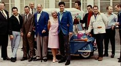 Elvis and the Memphis mafia in june 26 1965 for the Colonel Parker's birthday. Georges was there wearing the red shirt.