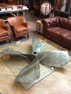 What a great idea! Loving this propeller glass table!