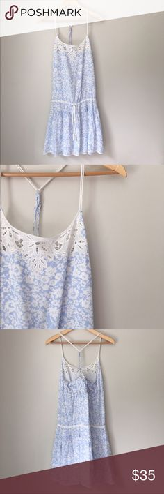 AEO Blue Cross Back Cami Drawstring Dress Beautiful soft blue cross back Cami Drawstring Dress by American Eagle Outfitters. 100% rayon. Size 6. Great condition. American Eagle Outfitters Dresses