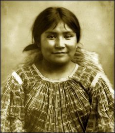 Portrait of Na-din-praquai-gizay, a young Apache woman.