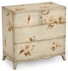 An elegant chest of three drawers with hand painted floral decoration.