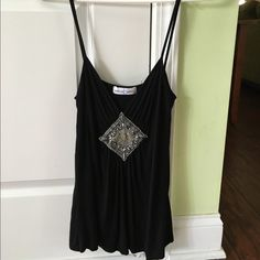 Black slinky tank with rhinestones Fun and flirty spaghetti strap tank in good used condition with no rips or stains. Flowy and loose. This is really cute for a date night with heels or even with shorts for the beach. Thanks for looking. Rebecca Beeson Tops Tank Tops