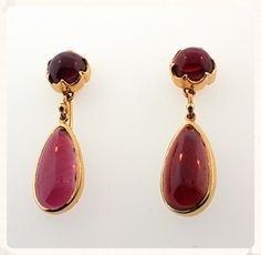 SOLD. These garnet drop earrings in 14K yellow gold are utterly magical.  With every movement, with the slightest adjustment to the light, the coloring of the gemstones changes from grape to raspberry to deep, dark cherry.