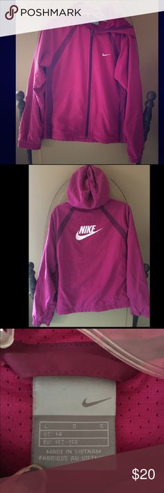 Pink Nike Girl's Hoodie This pink Nike hoodie is detailed with stripes, the classic Nike swoop on the front, and the word NIKE on the back. It is in good condition and has only been worn a few times, but has a dark mark on one sleeve (see fourth photo). Nike Jackets & Coats