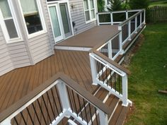 Spiced Rum Trex Deck - Home and Garden Design Ideas - notice how the deck comes right out from the siding -