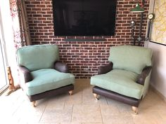 A pair of traditional, oak castor leg, feather filled armchairs, measuring 103 cm deep.  The front base / inside arm / front and top of arm are in Linwood F1856-003 Mahogany. Outside arm / inside and outside back plus base and back cushions in LF929-8 Metheven plain wool fabric. Bespoke Sofas, Cushion Filling, Wool Fabric, Armchairs, Cribs, Feather, British, Cushions