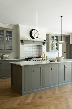 Muted grey cabinets, aged brass hardware