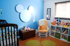 A disney land theme.. A wonderful child hood memory. I would love my kid to have a room like this.