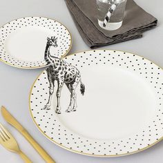 Yvonne Ellen gives forgotten vintage housewares a new lease on life by applying animal illustrations across matching dinner and side plates. Each plate is made from high quality fine bone china and. Giraffe Illustration, Animal Illustrations, Animal Plates, Teller Set, Plate Hangers, Tea Pot Set, Tea Sets, Ceramic Tableware, Porcelain Ceramic