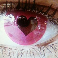 Pink black heart eye contacts.