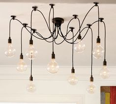 Edison Chandelier with draping cords and vintage-styled bulbs.