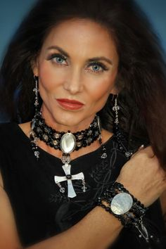 Black onyx sterling cross with mother of pearl center motif earrings of same material . at cowgirlkim.com