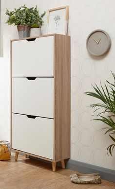 Fieldstone 6 Pair Shoe Storage Cabinet. Embracing the cool simplicity and clean lines of the Scandinavian style, Norden Home showcases a selection of natural materials, muted hues and minimalistic designs to fit your unique space